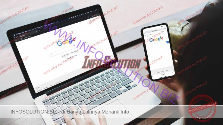 A woman is typing on google search engine from a laptop and cell phone. google is the biggest internet search engine in the world. Premium Photo